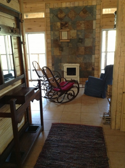 Rocking chairs in front of the woodburning stove.